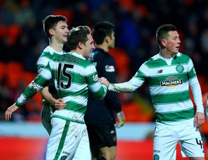 DUNDEE, SCOTLAND - JANUARY 15 Kris Commons of Celtic celebrates with his team mates after scoring a spectacular volleyed goal from distance in the second half during the Ladbrokes Scottish Premiership match between Celtic FC and Dundee United FC at Tannadice Park on January 15, 2016 in Dundee, Scotland. (Photo by Mark Runnacles/Getty Images)