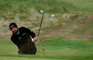 Ireland's Shane Lowry plays from a bunker on the 14th during day two of the Dubai Duty Free Irish Open at Royal County Down Golf Club, Newcastle. PRESS ASSOCIATION Photo. Picture date: Friday May 29, 2015. See PA story GOLF Irish. Photo credit should read: Brian Lawless/PA Wire. RESTRICTIONS: Editorial use only. No commercial use. No false commercial association. No video emulation. No manipulation of images.