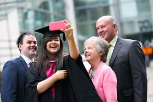 Graduating from Ulster University today with a degree in Graphic Design and illustration is Linda Davidson pictured with Brother Mark and parents May & Marshall. Picture John Murphy Aurora Photographic Agency.