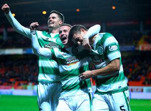 DUNDEE, SCOTLAND - JANUARY 15 : Jose Simunovic (R), of Celtic is congratulated by team mates Leigh Griffiths and Mikael Lustig after scoring a goal in the first half during the Ladbrokes Scottish Premiership match between Celtic FC and Dundee United FC at Tannadice Park on January 15, 2016 in Dundee, Scotland. (Photo by Mark Runnacles/Getty Images)