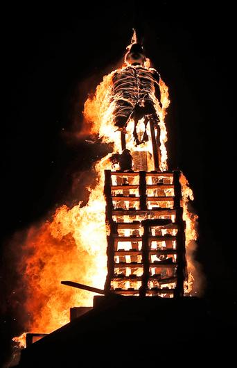 """A effigy of the historical figure Robert Lundy is burned as the huge bonfire in the loyalist Corcrain area of Portadown, Co Armagh, is lit on the """"Eleventh night"""" to usher in the Twelfth commemorations. Pic: Niall Carson/PA Wire"""
