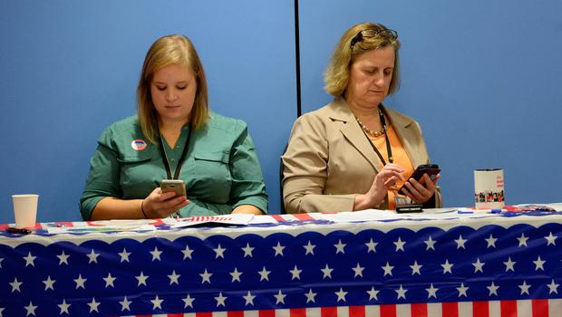 Two embassy staffs follow the results of the US presidential elections  during an election watch event at the US embassy in Hanoi on November 9, 2016. / AFP PHOTO / HOANG DINH NAMHOANG DINH NAM/AFP/Getty Images