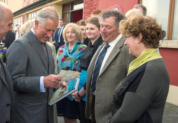 """Britain's Prince Charles, Prince of Wales (L) reads a letter from his great-uncle Lord Mountbatten shown to him by Daithi O'Dowd during a visit to the village of Mullaghmore in Ireland on May 20, 2015 where Lord Mountbatten was killed in an Ire bombing in 1979. Britain's Prince Charles spoke of his """"anguish"""" at the murder of his godfather by IRA paramilitaries in 1979 as he became the first royal to visit the assassination site in Ireland.  Charles remembered Lord Louis Mountbatten as """"the grandfather I never had"""" on an emotional trip to the rugged coastline, saying he understood the suffering of the Irish people in """"a profound way"""".  Peter McHugh helped with the rescue effort in the aftermath of the 1979 attack.  AFP PHOTO / POOL / ARTHUR EDWARDSARTHUR EDWARDS/AFP/Getty Images"""