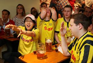 LONDON, ENGLAND - MAY 25:  Borussia Dortmund fans watch a tv screen showing the Champions League final against Bayern Munich in the Bavarian Beerhouse bar on May 25, 2013 in London, England. Bayern Munich and Borussia Dortmund are playing the Champions League final at Wembley Stadium.  (Photo by Peter Macdiarmid/Getty Images)