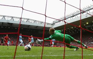 Philippe Coutinho of Liverpool scores his team's third goal during the Barclays Premier League match between Liverpool and Manchester City at Anfield on April 13, 2014 in Liverpool, England.  (Photo by Alex Livesey/Getty Images)