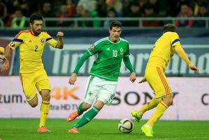Romania's Vlad Chiriches (right) and Paul Papp (left) battle for the ball with Northern Ireland's Kyle Lafferty during the UEFA Euro 2016 qualifier at the Arena Nationala, Bucharest. Nick Potts/PA Wire.
