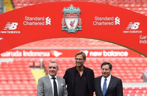 "Liverpool's new German manager Jurgen Klopp (C) poses on the pitch next to Liverpool's chairman Tom Werner (R) and managing director Ian Ayre (L) after a press conference to announce his new appointment at Anfield in Liverpool, northwest England, on October 9, 2015. Klopp described his job as ""the biggest challenge"" in world football on October 9 following his appointment as the successor to Brendan Rodgers. Former Borussia Dortmund head coach Klopp, 48, was appointed on October 8 on a three-year contract following the dismissal of Rodgers, who was sacked October 4 after three and a half years at the club.  AFP PHOTO / PAUL ELLIS    RESTRICTED TO EDITORIAL USE. No use with unauthorized audio, video, data, fixture lists, club/league logos or 'live' services. Online in-match use limited to 75 images, no video emulation. No use in betting, games or single club/league/player publications.PAUL ELLIS/AFP/Getty Images"