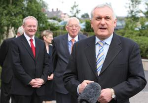 PACEMAKER PRESS BELFAST 17/7/2007 Taioseach Bertie Ahern  speaks to the press while First Minister Ian Paisley and Deputy First Minister Martin McGuinness look on from behind  at the first  meeting of the North-South Ministerial Council since the assembly which took place in Armagh City.  The meeting, in Armagh, includes members of the executive and Taioseach Bertie Ahern and other Irish ministers. Picture Mark Pearce/Pacemaker Press