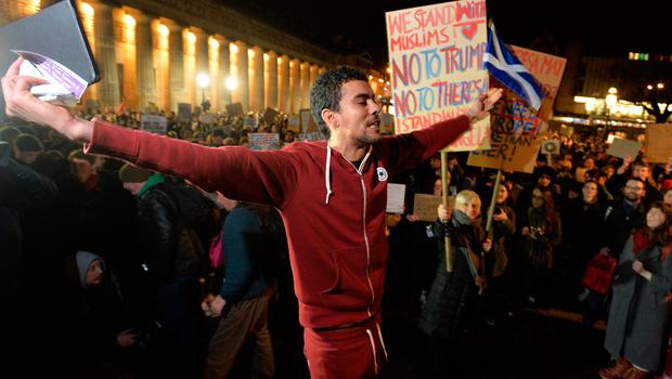 EDINBURGH, SCOTLAND - JANUARY 30: A young Muslim man speaks passionately to the crowd at the Mound as demonstrators march to the Scottish Parliament to protest against President Trump's Muslim travel ban to the USA on January 30, 2017 in Edinburgh, Scotland. President Trump signed an executive order on Friday banning immigration to the USA from seven muslim countries. This led to protests across America and, today, the UK. A British petition asking for the downgrading of Trump's State visit passed one million signatures this morning. (Photo by Mark Runnacles/Getty Images)