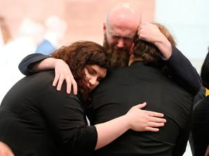 Mourners embrace ahead of the funeral of murdered journalist Lyra McKee at St Anne's Cathedral in Belfast.