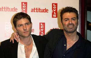 George Michael and Kenny Goss arriving for Attitude Magazine's 10th Birthday Party at the Atlantic Bar & Grill in central London. Pop superstar Mr Michael has died peacefully at home, his publicist said.