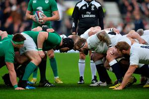 Players prepare for a scrum during the Six Nations international rugby union match between England and Ireland at Twickenham in south west London on February 27, 2016.   / AFP / GLYN KIRKGLYN KIRK/AFP/Getty Images