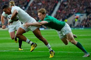 England's wing Anthony Watson (L) gets tackled during the Six Nations international rugby union match between England and Ireland at Twickenham in south west London on February 27, 2016.   / AFP / GLYN KIRKGLYN KIRK/AFP/Getty Images