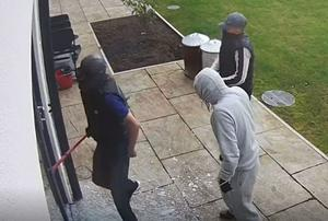 Screen grab from handout footage of Daniel Flynn (sleeveless, left) during a burglary of the home of Cardiff City footballer Sol Bamba (South Wales Police/PA)