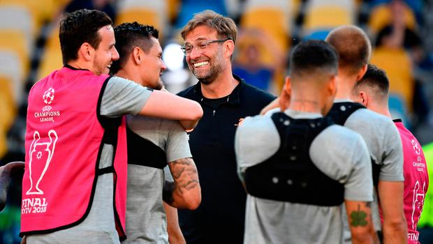Relaxed mood: Jurgen Klopp shares a joke with his Liverpool players yesterday ahead of tonight's Champions League final