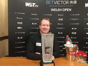 Jordan Brown celebrates with the Ray Reardon Trophy after his stunning Welsh Open victory.