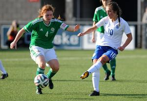 In the thick of it: Northern Ireland women's skipper Amy McGivern will take on England's Katie Zelem once again ahead of next year's Euro finals
