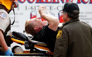 BOSTON, MA - APRIL 15:  A man is loaded into an ambulance after he was injured by one of two bombs exploded during the 117th Boston Marathon near Copley Square on April 15, 2013 in Boston, Massachusetts. Two people are confirmed dead and at least 23 injured after two explosions went off near the finish line to the marathon.  (Photo by Jim Rogash/Getty Images)