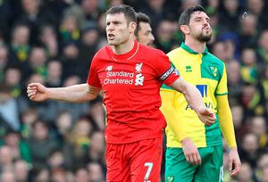 LiverpoolÕs captain English midfielder James Milner celebrates scoring their fourth goal during the English Premier League football match between Norwich City and Liverpool at Carrow Road in Norwich, eastern England, on January 23, 2016. AFP PHOTO / LINDSEY PARNABY  RESTRICTED TO EDITORIAL USE. No use with unauthorized audio, video, data, fixture lists, club/league logos or 'live' services. Online in-match use limited to 75 images, no video emulation. No use in betting, games or single club/league/player publications.LINDSEY PARNABY/AFP/Getty Images