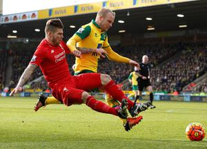 Liverpool's Spanish defender Alberto Moreno (L) vies with Norwich City's Scottish striker Steven Naismith during the English Premier League football match between Norwich City and Liverpool at Carrow Road in Norwich, eastern England, on January 23, 2016. Liverpool won the game 5-4. AFP PHOTO / LINDSEY PARNABY  RESTRICTED TO EDITORIAL USE. No use with unauthorized audio, video, data, fixture lists, club/league logos or 'live' services. Online in-match use limited to 75 images, no video emulation. No use in betting, games or single club/league/player publications.LINDSEY PARNABY/AFP/Getty Images