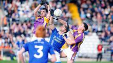 Air ball: Ryan Jones and Shane McGullion sandwich Frank Caulfield as they compete for a breaking ball