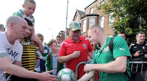 ?Press Eye Ltd Northern Ireland - 17th July 2013 Mandatory Credit - Picture by Darren Kidd /Presseye.com    Champions League, Cliftonville v Celtic.  Cliftonville v Celtic,  Champions League 2nd Qual, 1st Leg game at Solitude, Belfast. liftonville's George McMullan sign autographs for fans ahead of the game.