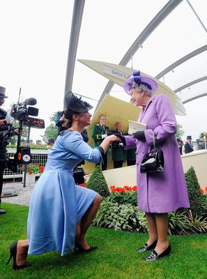 ASCOT, ENGLAND - JUNE 20:Queen Elizabeth II is congratulated by  Princess Haya bint Al Hussein  on Ladies' Day during day three of Royal Ascot at Ascot Racecourse on June 20, 2013 in Ascot, England.  (Photo by Charlie Crowhurst/Getty Images for Ascot Racecourse)