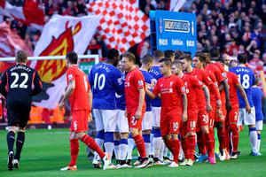LIVERPOOL, ENGLAND - APRIL 20:  The two sides shake hands prior to the Barclays Premier League match between Liverpool and Everton at Anfield, April 20, 2016, Liverpool, England  (Photo by Clive Brunskill/Getty Images)