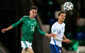 Northern Ireland's Gavin Whyte (left) and Slovakia's Samuel Mraz battle for the ball during the UEFA Euro 2020 Play-off Finals match at Windsor Park, Belfast. PA Photo. Picture date: Thursday November 12, 2020. See PA story SOCCER N Ireland. Photo credit should read: Liam McBurney/PA Wire.