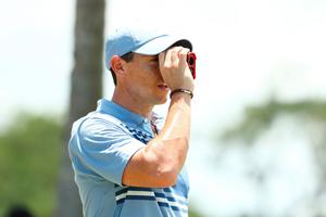 JUNO BEACH, FLORIDA - MAY 17: Rory McIlroy of the American Nurses Foundation team uses a rangefinder on the practice range during the TaylorMade Driving Relieve Supported By UnitedHealth Group on May 17, 2020 at Seminole Golf Club in Juno Beach, Florida. (Photo by Mike Ehrmann/Getty Images)