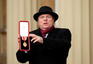 Singer, songwriter and musician Sir Van Morrison at Buckingham Palace, London, after being knighted by the Prince of Wales.