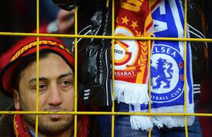 A  Galatasaray fan looks through the fence during the UEFA Champions League Round of 16 first leg match between Galatasaray AS and Chelsea at Ali Sami Yen Arena on February 26, 2014 in Istanbul, Turkey.  (Photo by Michael Regan/Getty Images)