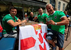 Northern Ireland football fans descend upon Place Antonin Poncet, adjacent to the fan zone in Lyon, France.