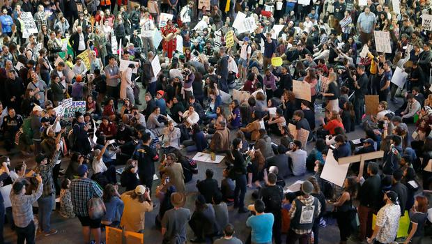 Hundreds of demonstrators gather on the roadway during a protest against President Donald Trump's executive order banning travel to the United States by citizens of several countries at Los Angeles International Airport, Sunday, Jan. 29, 2017. (AP Photo/Ryan Kang)