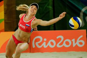 Russia's Evgenia Ukolova tries to receive the ball during the women's beach volleyball lucky loser round match between Czech Republic and Russia at the Beach Volley Arena in Rio de Janeiro on August 11, 2016, for the Rio 2016 Olympic Games. / AFP PHOTO / YASUYOSHI CHIBAYASUYOSHI CHIBA/AFP/Getty Images