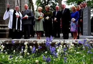 SLIGO, IRELAND - MAY 20:  (L-R) The Very Rev. Arfon Williams, Prince Charles, Prince of Wales and Camilla, Duchess of Cornwall, Former President of Ireland Mary McAleese, Martin McAleese, and Minister of Foreign Affairs Charlie Flanagan attend a tree planting ceremony after a service of peace and reconciliation at St. Columba's Church in Drumcliffe on the second day of a four day visit to Ireland on May 20, 2015 in Sligo, Ireland. The Prince of Wales and Duchess of Cornwall arrived in Ireland yesterday for their four day visit to the Republic and Northern Ireland, the visit has been described by the British Embassy as another important step in promoting peace and reconciliation.  (Photo by Brian Lawless - WPA Pool/Getty Images)