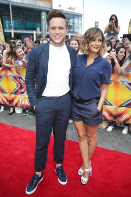 Olly Murs and Caroline Flack presented the X Factor in 2015 (Daniel Leal-Olivas/PA)