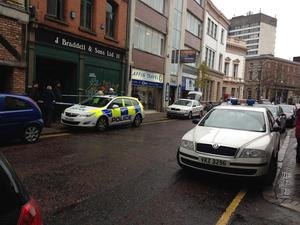 Police and NIFRS officers were called to a fire at J Braddell & Sons Ltd fishing tackle shop on North Street, Belfast.