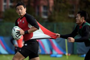 Japan's full-back Ayumu Goromaru (L) attends a team training session at Brighton College in Brighton, on September 17, 2015, on the eve of the opening match of the 2015 Rugby Union World Cup.     AFP PHOTO / LIONEL BONAVENTURE  RESTRICTED TO EDITORIAL USELIONEL BONAVENTURE/AFP/Getty Images