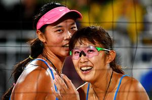 China's Wang Fan (L) and Yue Yuan react the women's beach volleyball qualifying match between the USA and China at the Beach Volley Arena in Rio de Janeiro late on August 8, 2016, for the Rio 2016 Olympic Games. / AFP PHOTO / Leon NEALLEON NEAL/AFP/Getty Images