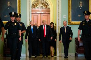 WASHINGTON, D.C. - NOVEMBER 09: Senate Majority Leader Mitch McConnell (R-KY) walks with President-elect Donald Trump and his wife Melania Trump,  to his office before a meeting at the U.S. Capitol on November 10, 2016 in Washington, DC. Earlier in the day president-elect Trump met with U.S. President Barack Obama at the White House. (Photo by Zach Gibson/Getty Images)