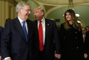 US President-elect Donald Trump (C) walks with his wife Melania Trump and Senate Majority Leader Mitch McConnell (R-KY) on Capitol Hill in Washington,DC on November 10, 2016. / AFP PHOTO / YURI GRIPASYURI GRIPAS/AFP/Getty Images