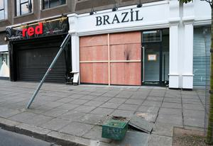 The shop on Wellington Place which was rammed with a Volkswagen saloon on Sunday.