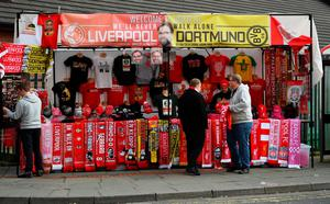 LIVERPOOL, ENGLAND - APRIL 14:  Fans gather by a merchandise stall prior to the UEFA Europa League quarter final, second leg match between Liverpool and Borussia Dortmund at Anfield on April 14, 2016 in Liverpool, United Kingdom.  (Photo by Shaun Botterill/Getty Images)