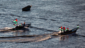 Palestinians sail boats bearing their national flag in the port of Gaza City in support of the Gaza-bound flotilla of international female activists attempting to break the Israeli blockade on the Gaza Strip on October 5, 2016. AFP/Getty Images