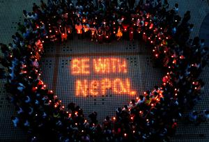 TOPSHOTS This picture taken on April 26, 2015 shows Nepalese students and Chinese students gathering to pray for Nepal in Nanhua University in Hengyang, central China's Hunan province. International rescue teams and relief supplies began arriving in Nepal's devastated capital on April 27 to help terrified and homeless survivors of a quake that has killed more than 3,200 people in the impoverished nation. CHINA OUT AFP PHOTOSTR/AFP/Getty Images
