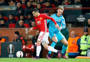 Manchester United's Henrikh Mkhitaryan (left) and Feyenoord's Nicolai Jorgensen battle for the ball during the UEFA Europa League match at Old Trafford, Manchester. PRESS ASSOCIATION Photo. Picture date: Thursday November 24, 2016. See PA story SOCCER Man Utd. Photo credit should read: Martin Rickett/PA Wire