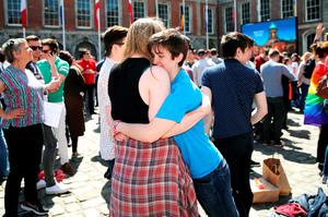 People gather at  the Central Count Centre in Dublin Castle, Dublin as votes are continued to be counted in the referendum on same-sex marriage.  PRESS ASSOCIATION Photo. Picture date: Saturday May 23, 2015. Ireland is set to enshrine the right to gay marriage in a historic world first. Key campaign groups fighting the rights reform conceded defeat, with results from around the country indicating a two to one majority of voters backing the constitutional change. See PA story IRISH GayMarriage. Photo credit should read: Brian Lawless/PA Wire