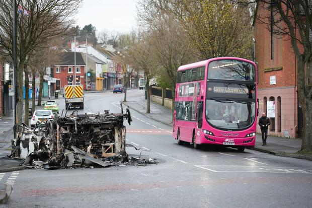 The remains of a burnt out bus on Belfast's Shankill Road. Pic Presseye