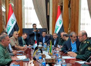 Iraqi Defence Minister Khaled al-Obeidi (L) and his Iranian counterpart Hossein Dehghan (R) attend a meeting at the defence ministry in Baghdad on May 18, 2015. Dehghan arrived in the Iraqi capital for talks with his counterpart, a day after the Iraqi government suffered one of its worst losses with the fall of Ramadi, some 120 kilometres west of Baghdad, to Islamic State (IS) group jihadists. AFP PHOTO / STR-/AFP/Getty Images